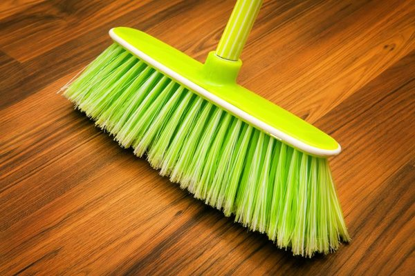sweep or vacuum hardwood floors